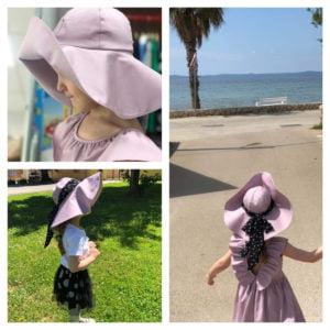lila anđela haljina i anđela šešir velikog oboda