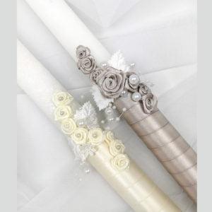 svijeće ukrašene ručno ređenim cvjetićima