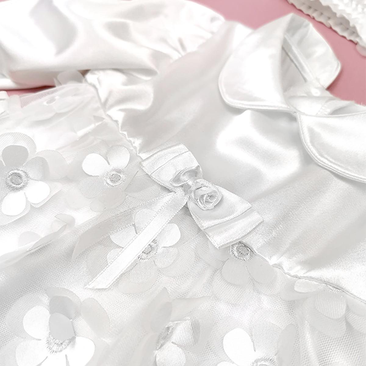 detalji bijele haljine Aria za krštenje