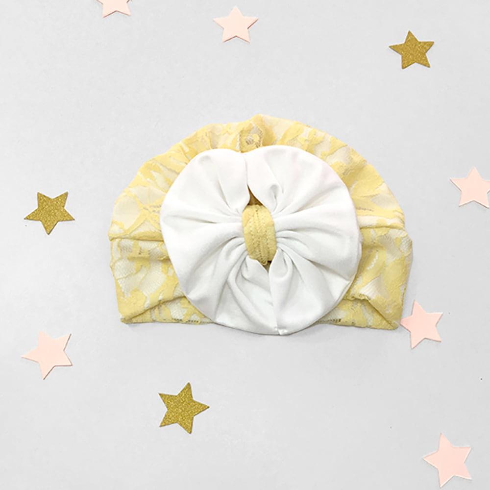 žuta kapica turban s velikom bijelom mašnom