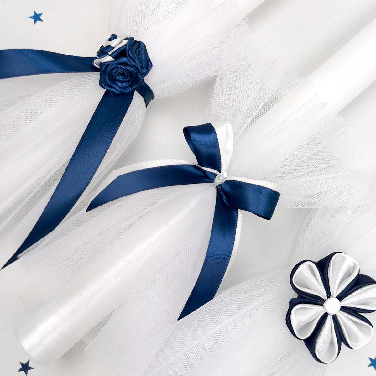 tamno plave svećano ukrašene svijeće za krštenje